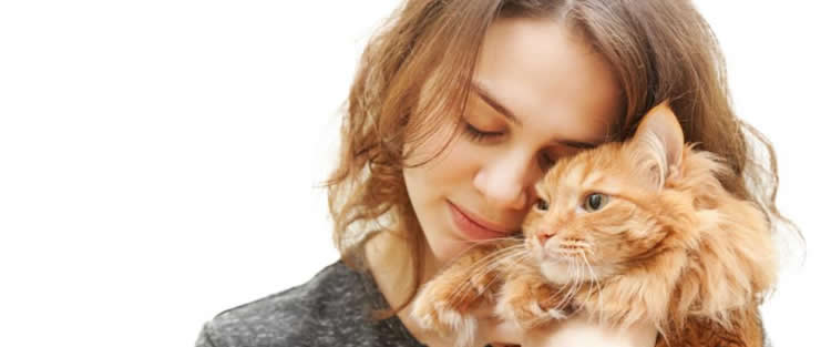 Photo of a young woman and a kitten.