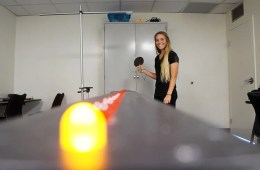 Image shows a test participant hitting a colored ball.