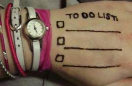 "Photo of a hand with a ""to do"" list written on it."