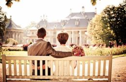 Photo of a couple sitting on a bench.