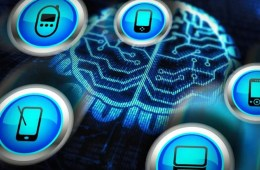 Image shows the shape of a brain mad eof computer chips and mobile device icons