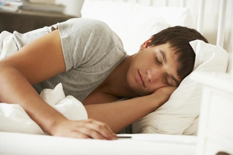 Image shows a man sleeping.
