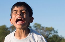 Image shows a screaming little boy.