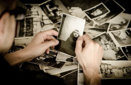 Image of a person looking at old photos.