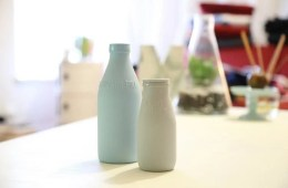 Image shows old fashioned milk bottles.