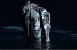 Image shows a model of a head split into 3 pieces.