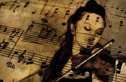 Image shows woman playing the violin and sheet music.