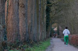 Image shows a man jogging.