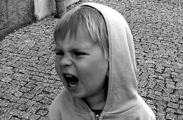 Image shows a screaming child.