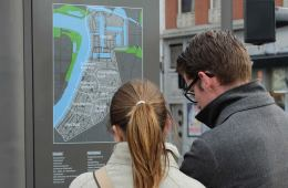 Image shows a woman looking at a map.
