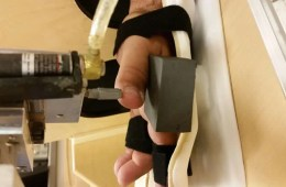 Image shows a person's hand being stimulated.