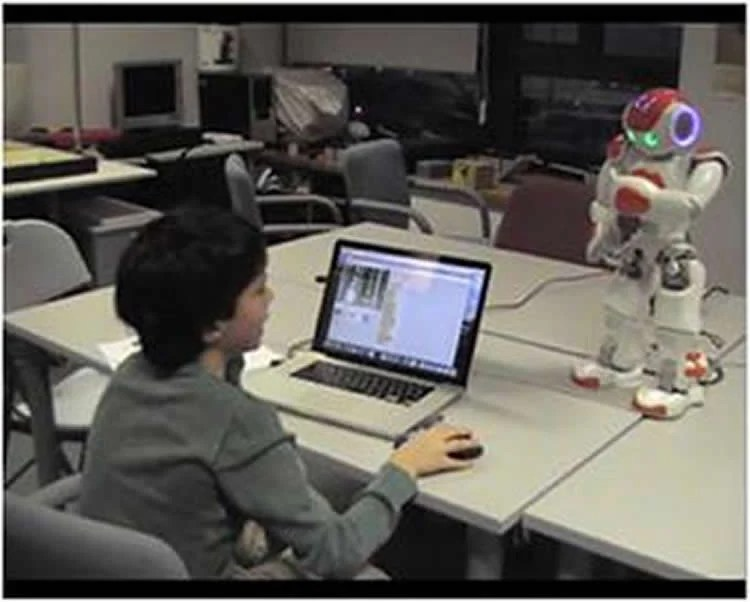 Image shows a child and a robot.