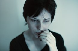 Image shows a anxious looking woman.