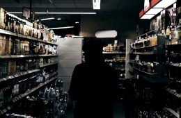 Image shows a person buying alcohol.