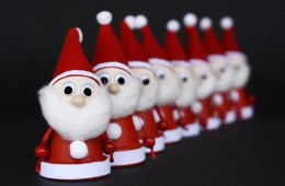 Image shows a line of of santas.