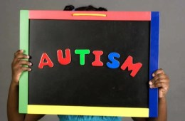 Image shows the word Autism on a blackboard.