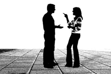 Image shows a couple talking.