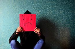 Image shows a person with depression.
