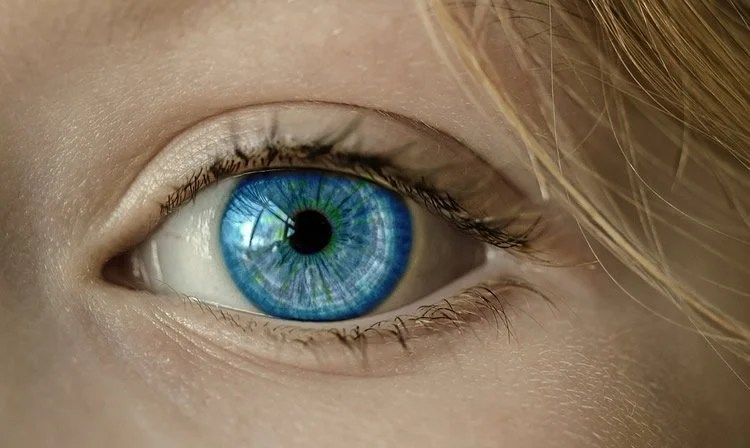 Image shows a blue eye.
