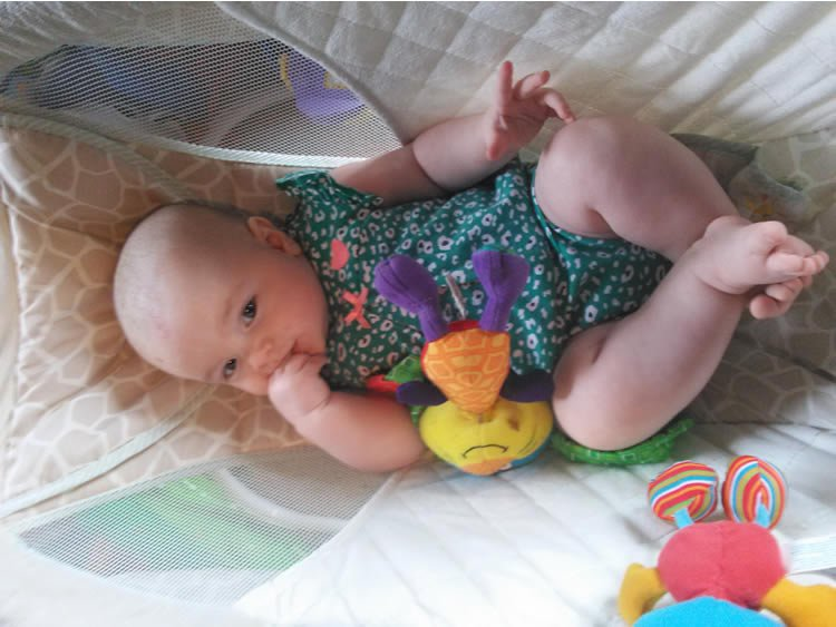 Image shows a gorgeous little baby girl with a very naughty toy bunny.