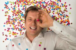 Image shows the researcher covered in Smarties.