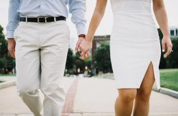 Image shows a couple holding hands.
