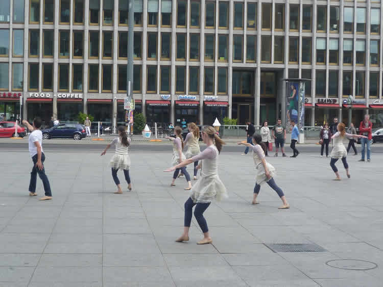 Image shows women performing tai chi.