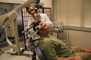 Image shows the research applying tms to a depression patient.