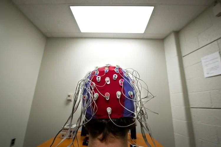 a person in an eeg cap.