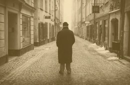 Image shows an old person walking down a street.