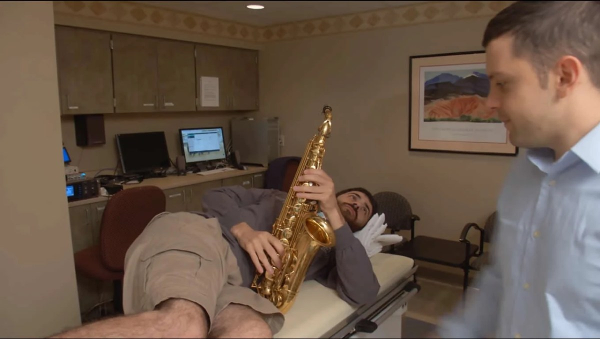 Image shows the patient with his saxophone.