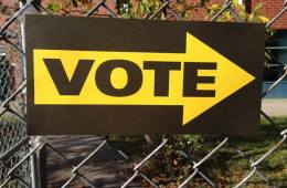 Image shows a voting station sign.