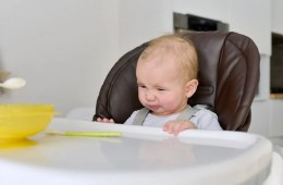 Image shows toddler at a table.