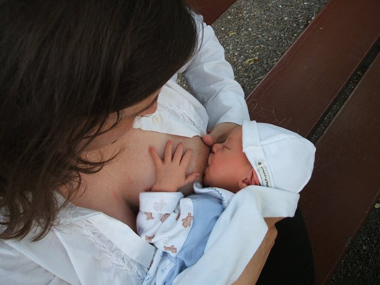 Image shows a breastfeeding mother.