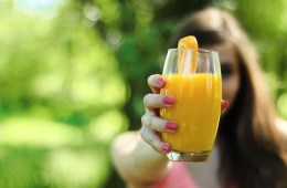Image shows a glass of orange juice.