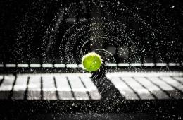 Image shows a tennis ball bouncing.