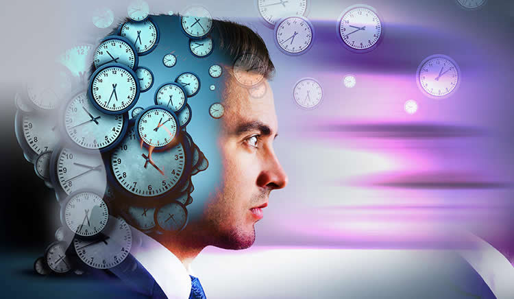 Image shows a a man's head made up of clocks.