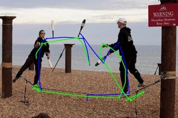 Image shows people juggling on a beach.