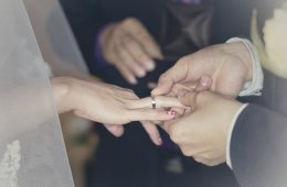 Image shows people getting married.