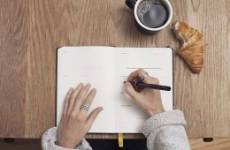 Image shows a person writing.