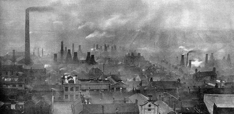 Image shows an old photo of factories.