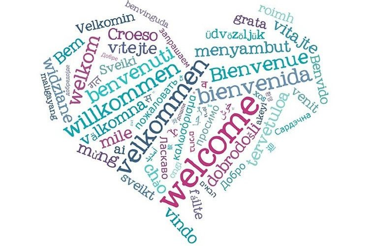 Image shows heart made up of words in different languages.