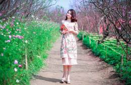 a woman walking in flowers