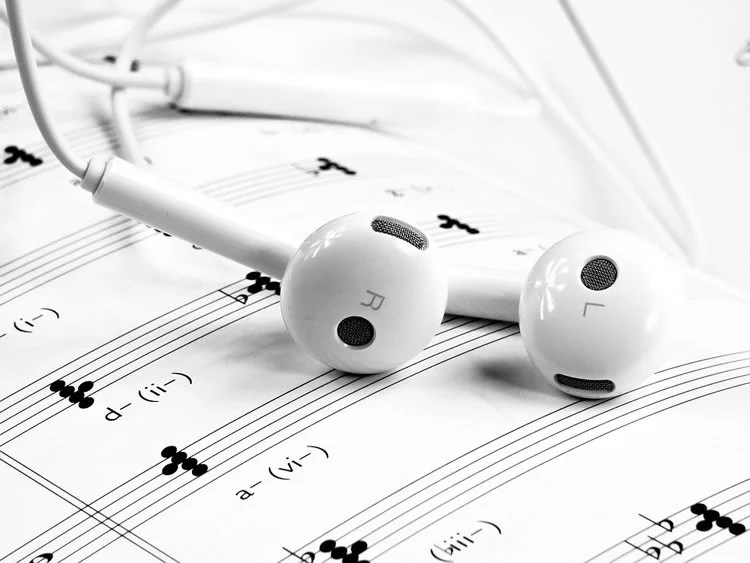 sheet music and headphones
