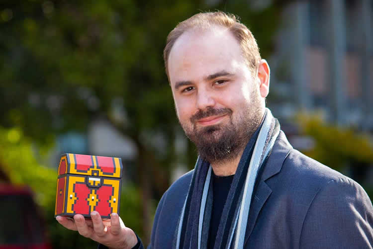 the researcher holding a mock loot box