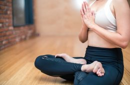 a woman in the lotus position