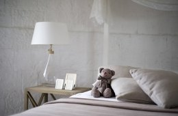 a teddy bear on a bed