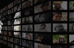 a woman looking at a screen covered in photos