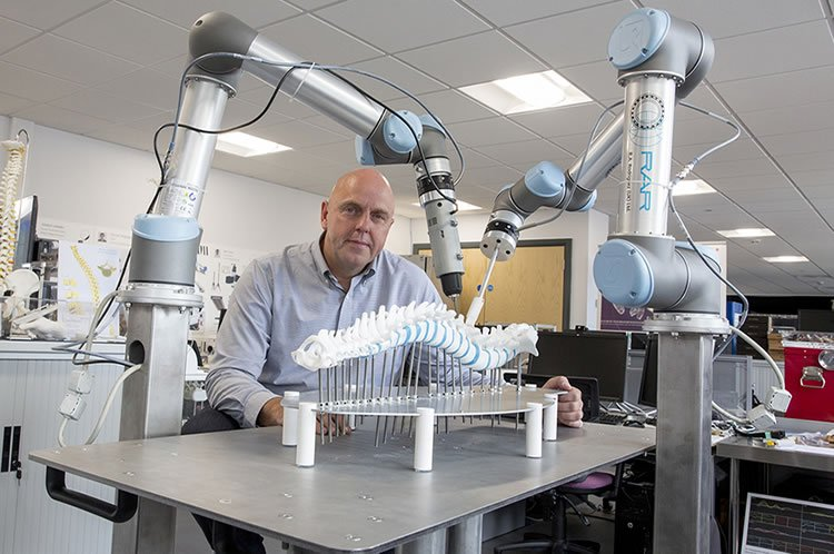 the doctor and the robotic arms