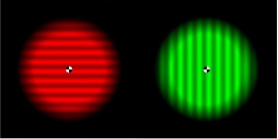 A red glowing circle with horizontal lines is next to a green glowing circle with vertical lines.